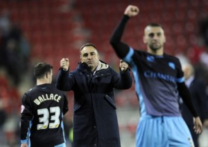 Carvalhal celebrates with his players after the Owls win at Rotherham