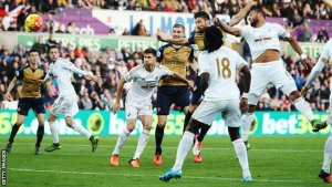 Olivier Giroud heads the Gunners in front at the Liberty Stadium