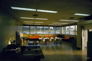 This picture from Shorpy of a 1950s lounge in an IBM plant is bizarre: it looks almost identical to my 1970s elementary school style, down to the chairs, the orange couches, the magazine racks, and the acoustic tile.