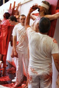 Hermann Nitsch was a premier guest at the 2009 Incubate arts festival in Tilburg, Netherlands. In this photo assistants undergoing mock crucifixions drink and bath in animal blood.