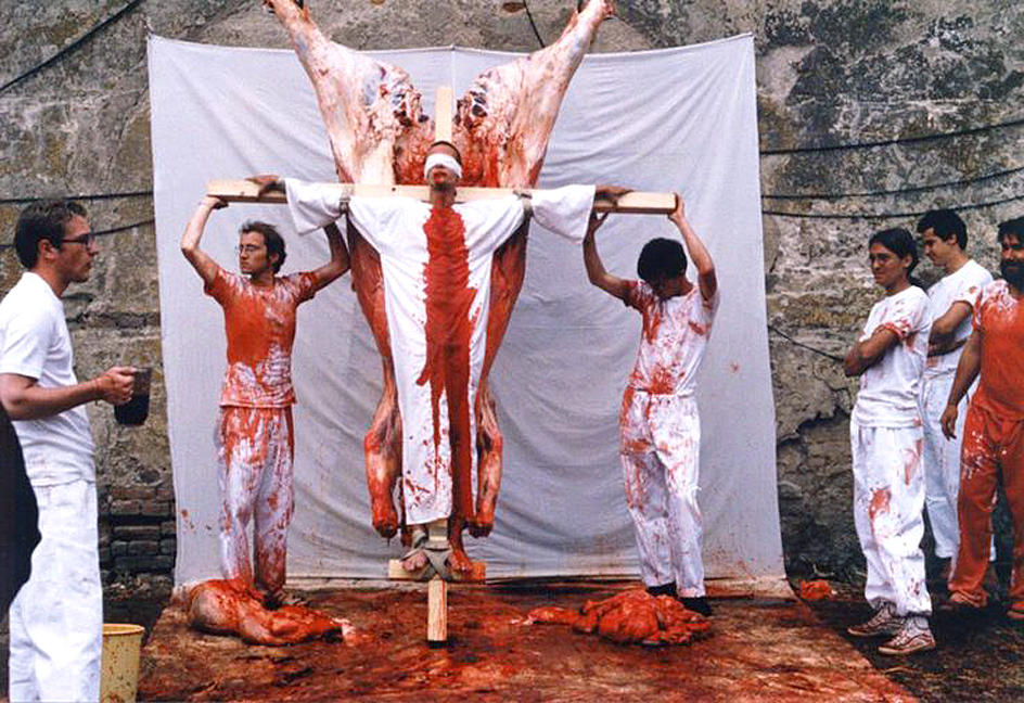 Hermann Nitsch performance, date, place, and photographer unknown. In this photo assistants use cow, lamb, and pig entrails and blood.