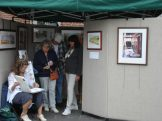 Elaine and visitors at her 3rd Street booth