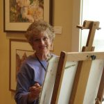 Sue Bennett paints at Oregon Street Gallery