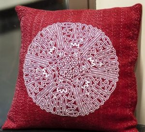 Bobbin lace embellished pillow by Shirley McFarland.