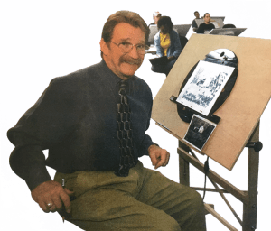 Picture of Phil Young at his drawing board when he was teaching art.