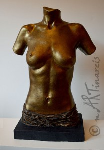 Female half torso made ​​of plaster, bronze finish with drapery