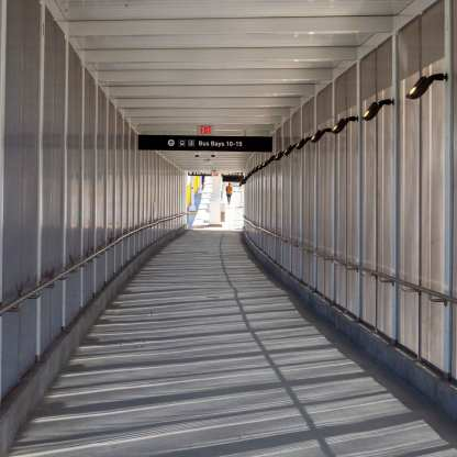 Wind Bridge is a system of integrated metal panels along the pedestrian bridge connecting a new busway station to Union Station and Patsaouras Transit Plaza.