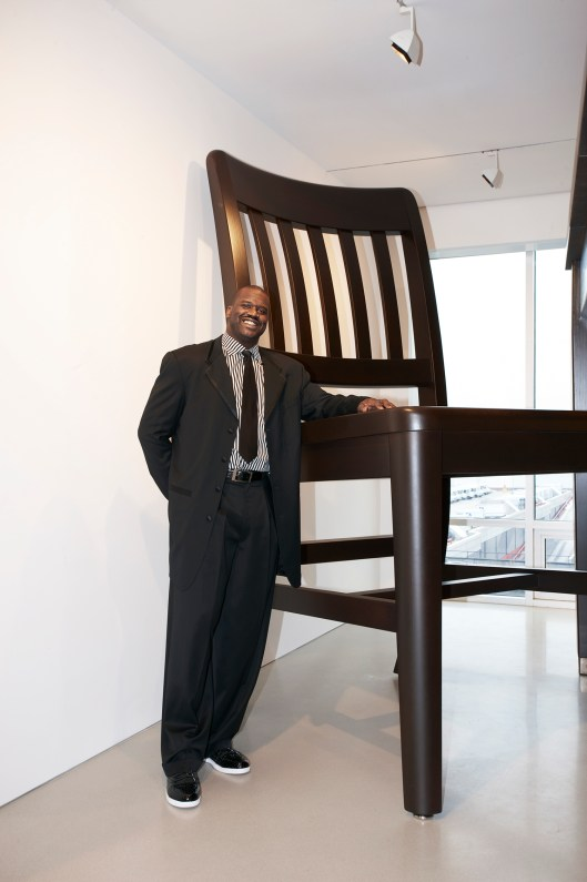 """Shaquille O'Neal standing in """"SIZE DOES MATTER,"""" an exhibition he curated for the FLAG Art Foundation in 2010"""