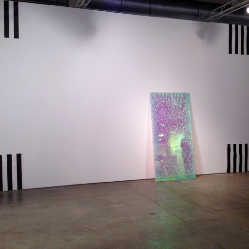 """Daniel Buren's painted fabric """"One Piece in Four Parts,"""" 1976 and Ann Veronica Janssens' """"Magic Mirror Pink,"""" 2013, diachronic polyester film, security glass, float glass (Booth #306)"""