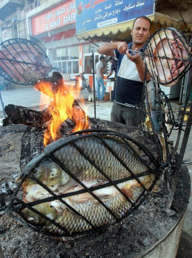 "Traditional preparation of masgouf, the fish dish to be prepared as part of Michael Rakowitz's ""Every Weapon Is A Tool If You Hold It Right"""