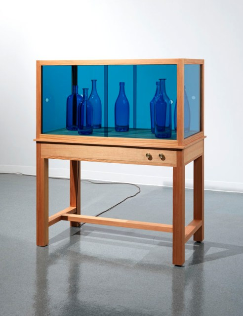 "Josiah McElheny. ""End of a Love Affair,"" 2014, handblown and polished glass, douglas fir, speakers, amplifier, industrial audio player, electric wiring, cut and polished blue sheet glass, brass control knobs, felt, hardware, 55 x 43 x 23 inches"