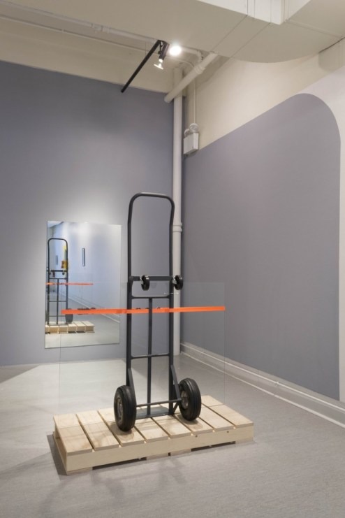 "Rafael E. Vera. ""Hold,"" 2015 pine, hand truck, glass, ratchet strap, mirror Photo Credit: April Alonso"