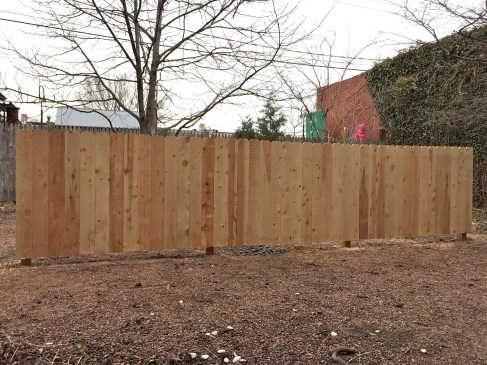 """Alberto Aguilar. """"A Crossing,"""" 2015 wood fence and mulch (not show), installation at Riverside Art Center"""