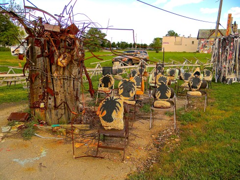 """Olayami Dabls. """"Iron Teaching Rocks How To Rust,"""" 2007,  iron, wood, concrete, metal, chairs, paint and vinyl, MBAD African Bead Museum in Detroit, MI. Photo credit: Charlene Uresy"""