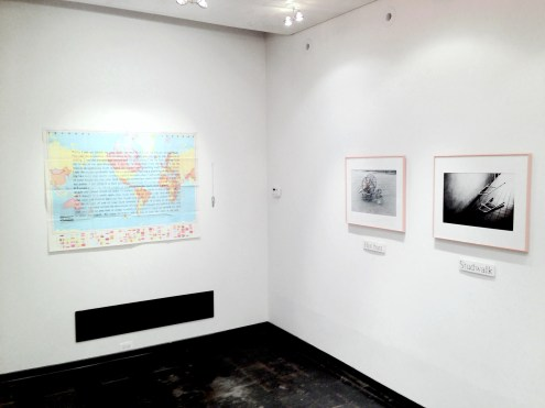 """Installation view of """"Militant Eroticism"""" at Iceberg Projects. From left: David Wojnarowicz wall installation; Ray Novarro's photo installation """"Equipped."""""""