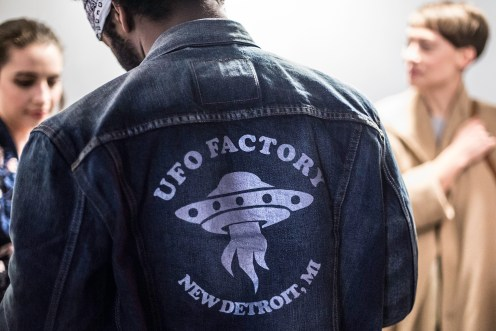 A jacket in the crowd promotes UFO Factory and a new conception of Detroit. Photo credit: Monica McGivern.