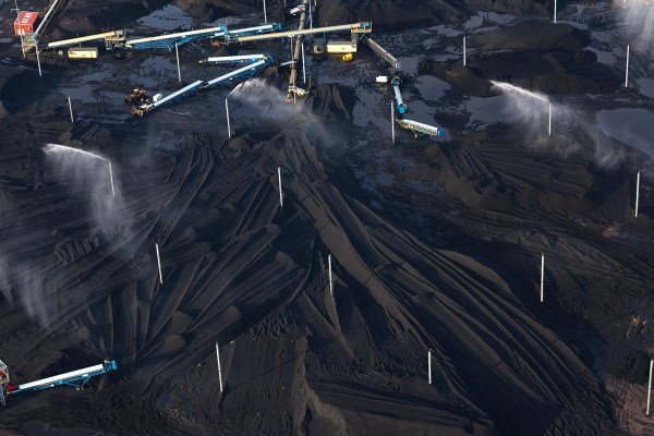 """Terry Evans, """"Petcoke piles with sprinklers at KCBX site on Calumet River,"""" 2014"""