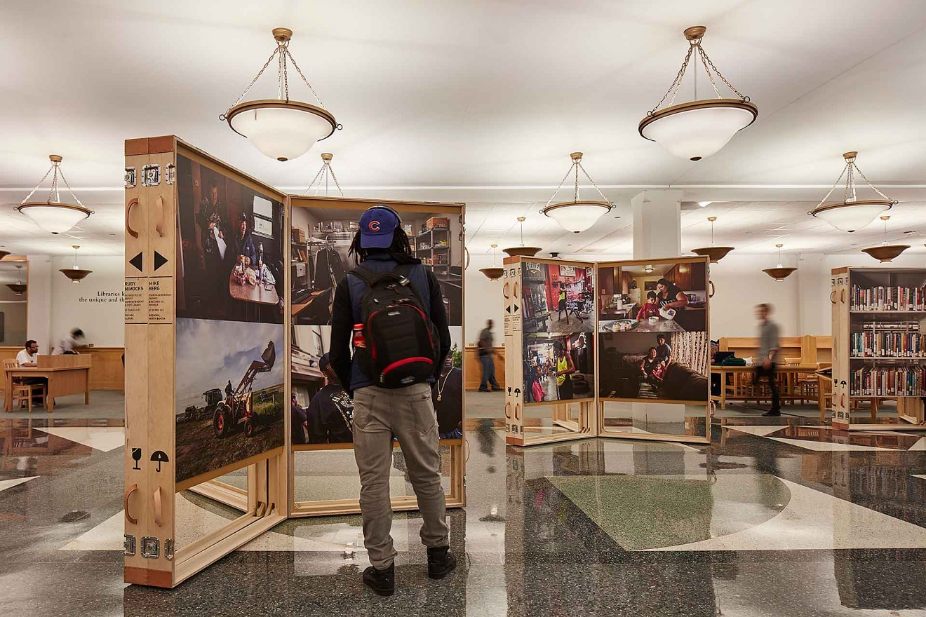 "Lynsey Addario and Studio Gang, Installation view of ""Working in America"" at the Harold Washington Library, Winter 2016"