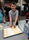 Filling trays with cookies