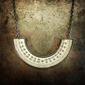 """Naomi Muirhead, """"Protractor Necklace - U,"""" 18k gold, sterling silver, vintage metal protractor"""