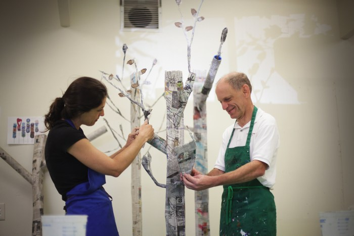 """""""Pulling The Forest Along The Road"""" Darren Petersen and Diana Markessinis Working at Hope Center For The Arts Photo Credit Eric Stoner"""