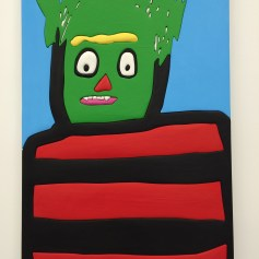 """""""Green Zombie,"""" 2016, Wood, aqua resin, casein, acrylic gouache, and Euro Lux, 49"""" H x 32"""" W,Sadie Benning. Blinded by the Light. Susanne Vielmetter Los Angeles Projects. Installation View. Photo Credit Jody Zellen."""