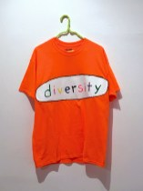 "Diversity Sells acrylic and puffy paint on t-shirt 22"" x 36"" 2017. Don Procella. Everything Must Go. Noysky Projects. Photo Courtesy of Noysky Projects."