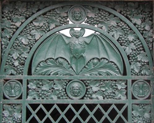 Bat motif on tomb door. Photo © Carolyn Campbell.