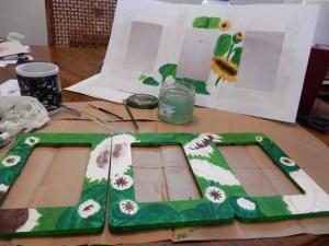 Hand-painted sunflower photo frames in progress
