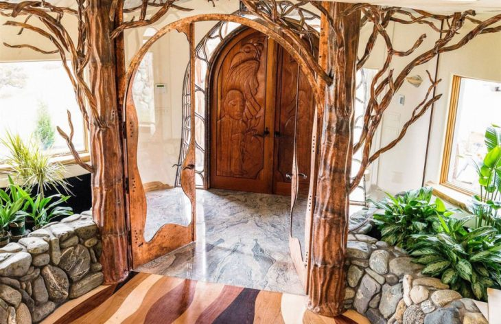 Nature-inspired tree sculptures continue to hug and enhance the architecture of this unique home