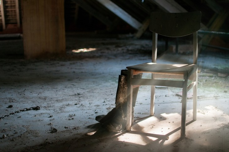 Chair and Boots Inside an Abandoned Home