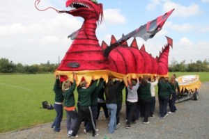 Arts in education - group make large dragon float with Artastic