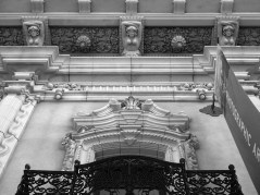 A black and white photo of the eaves at the Museum of Photographic Arts