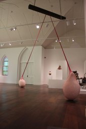 "2014, coil-built earthenware, terra sigillata, hand knit and dyed cotton net, wood, steel, dimensions vary: ceiling height: 18', forms: approx. 30 X 20"", Installed at Foothills Art Center, Golden, CO."