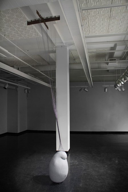 "2012, coil-built earthenware, terra sigillata, hand knit and dyed cotton net, steel saw blade, form: approx. 30 X 20"", ceiling height: 14', Installed at UMASS Dartmouth Star Store, New Bedford, MA."