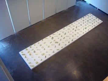 Democracy, 2012, 20' x 4' x 1', 138 ceramic objects