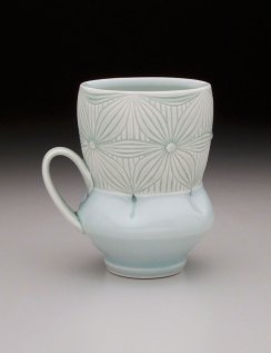 Porcelain with carved pattern, 4.5H x 4.5W x 3.5D""