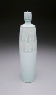 Porcelain with carved pattern, 16H x 4W x 4D""