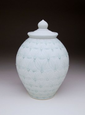 Porcelain with carved pattern, 15H x 9W x 9D""