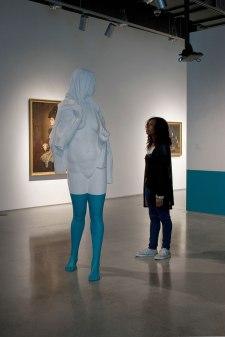 """Installation at the Zuckerman Museum of Art (Kennesaw, GA), painted Aqua Resin and video projection, figure is 84"""" tall"""