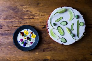 Black porcelain, earthenware, porcelain slip, glaze, cucumbers, yogurt and edible flowers.  food by Dan Barber. photograph by Andrew Scrivani