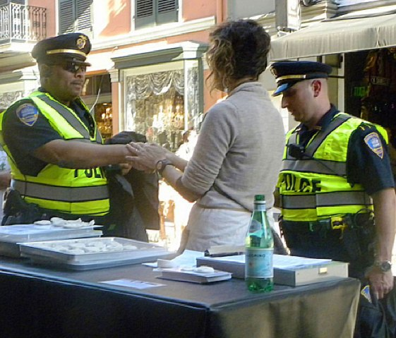 "Holly Hanessian, ""Touch in Real Time Project, Handshake with Policemen in NOLA"""