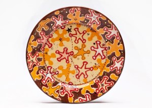 Sheriff Stars Dessert Plate, 2014. Ceramic, slip, underglaze, glaze and luster. Multi-colored screen printed underglaze transfers, shellac resist and multi-fired in an electric kiln. 1.25 x 7.25