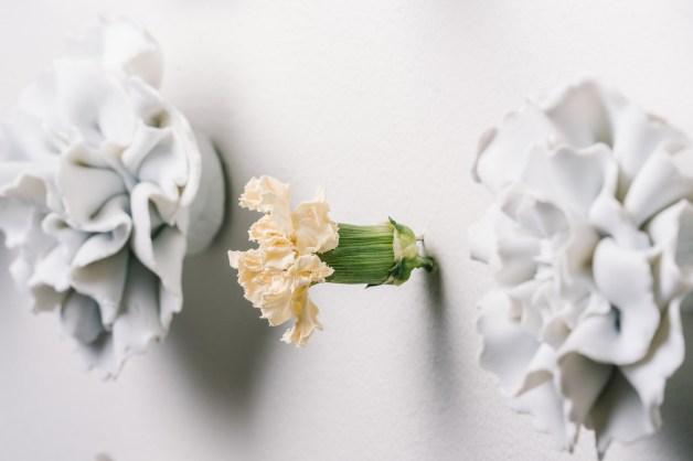 "2017, 49"" x 109"" x 3"", Handbuilt porcelain flowers & real carnations, Photo credit: Eric Mueller"