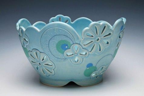 "Drape-molded, altered, and built porcelain w. pierced, carved, slip-sponge, slip-trail, underglaze, and Mishima deco, cone 7 oxidation. 6.5"" h x 11"" l x 9"" d, 2014"