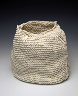"""7.5""""h x 8""""w x 5""""d, 2017, hand knit cotton, dipped in porcelain slip, fired cone 6 oxidation, unglazed."""