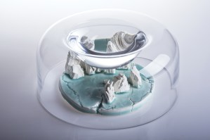 The collection consists of glass objects inside which there are porcelain landscapes. The water in the cavity of the glass form creates a magnifying glass, which allows to look closely at the micro-landscape, but prevent from touching them. Hiding the islands under cloaks may suggest danger, isolation and exclusion of this fragment of nature. It may also mean that it is hidden as the last parts of the world undamaged by humans. Is there still a place on Earth where man has not left his mark?