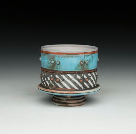 "3""H x 3""x 3""L. Earthenware, wheelthrown. Terra sigillita, underglaze. Electric fired cone 04"