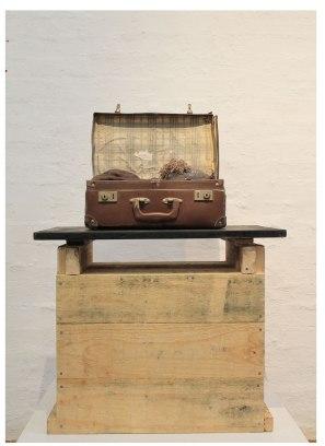 Ceramic, found suitcase, blanket, thread and wood, 63cm x 40cm x 90cm, 2014