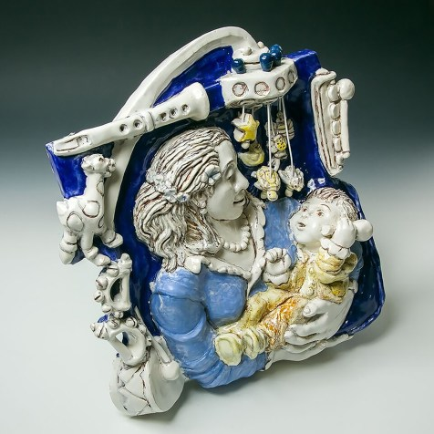 After an inspiring exhibition at the Boston Museum of Fine Arts on Della Robbia's work, in 2016, I tried to figure out how I might work in this Majolica technique. Having just become a grandmother, as you can see in this image. I painted a brown underglaze into the details. After bisque firing, majolica glaze colors were applied, and I scratched away at the details to reveal the brown line. I love the majolica process as you can see what you are doing the whole time.